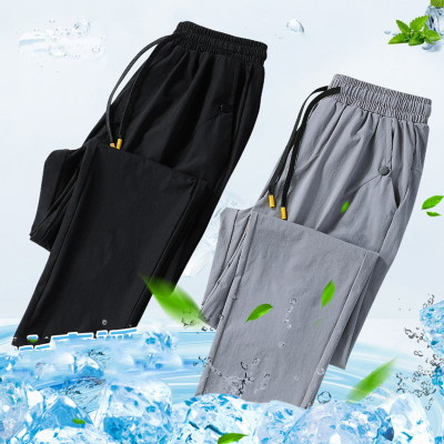 夏款大码男冰丝休闲裤韩版修身速干裤男2020新款潮流小脚弹力长裤