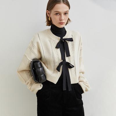 范洛2020冬季羊毛俏皮减龄蝴蝶结镂空麻花纹正反两穿毛衣开衫女